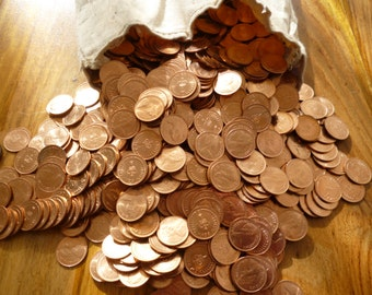1973 Halfpence coins a bulk pack of 25 uncirculated halfpennies from the UK Royal Mint.