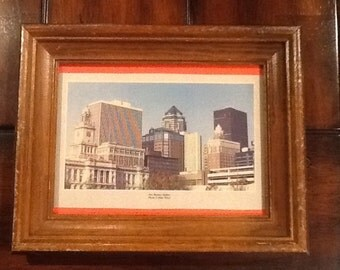 """Vintage collectible souvenir framed photograph of """"Des Moines skyline, Photo by Mike Whye. Distressed frame with old photo of downtown Des M"""