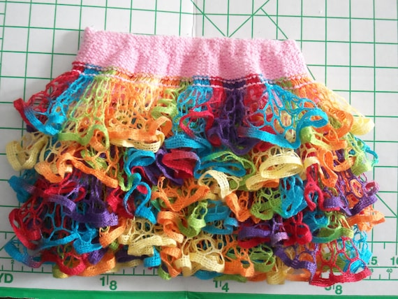 Baby or Toddler ruffled skirt. Multicolor with pink waistband.