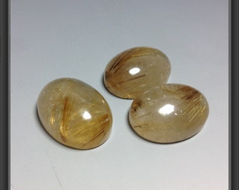 Gold rutilated quartz cabochon 15x20mm / 8 - 9mm thick