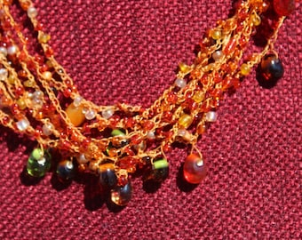Amber and green beaded and crocheted necklace