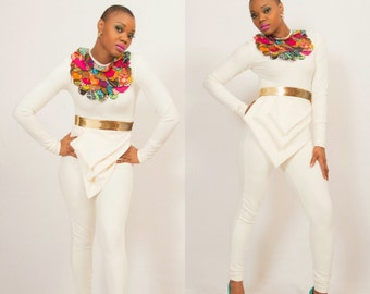 ON SALE | SAVE 40 %   Accentuated jumpsuit with attached neck piece