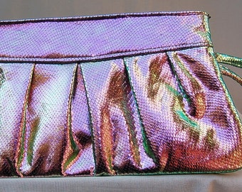 Iridescent colored patent evening clutch purse, with pleated detail in the front.  It has a matching wrist strap, and black satin lining.
