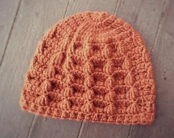 Handmade heathered orange cable puff patterned crochet hat - TO BE NAMED