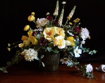 Large flower arrangement in old Dutch masters style.  Yellows and creams predominate.