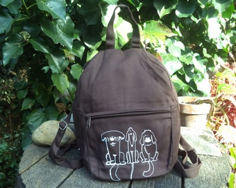 Brown canvas small backpack with dogs