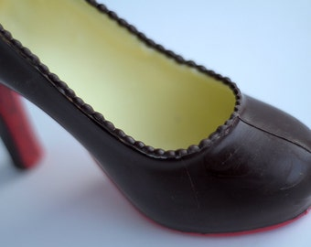 Pair of chocolate Louboutin shoes