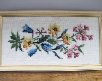 Vintage framed needlepoint of flowers.