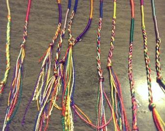 Grab bag of 3 wrapped woven friendship bracelets