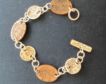 Periapt stamped bracelet.