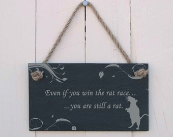 A Natural Slate Hanging Sign etched with the message 'Even if you win the rat race... you are still a rat' (SR309)