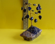 A beautiful vintage  hand made blue lapis lazuli coloured little wired bonsai gemstone tree standing on rock crystal base