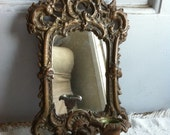 On hold......Heavy vintage brass mirror with candle holder