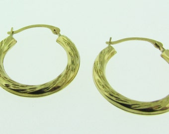 Yellow gold small hoop earrings.