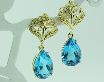 Vintage gold and topaz dangle filigree dangle earrings.