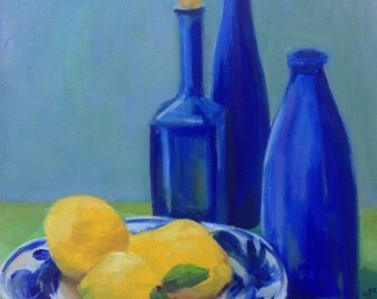 blue bottles with lemons in a delft plate
