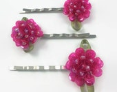 Set of three pink sequined flower bobby pins with green ribbon leaf accents