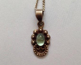 Dainty little vintage sterling silver pendant