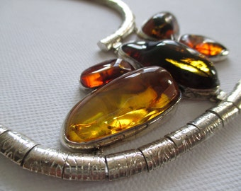 Silver necklace with amber stones