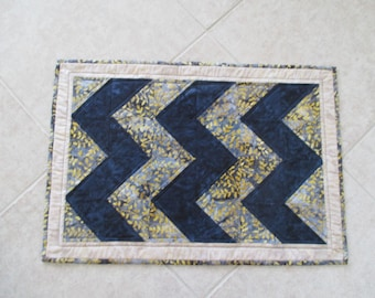Table runner, table topper or a wall hanging.