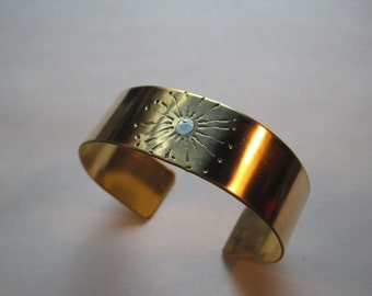 Mixed metal sunburst cuff bracelet