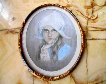 Vintage picture of Dutch girl in ornate wooden frame.