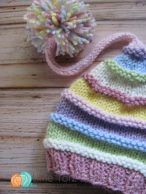 Knitting Pattern For Hat With Long Tail : Long Tail Pom Pom Hat with Ridges - Knitting Pattern - Newborn from LittleTot...