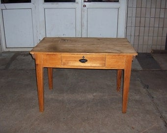 Old solid wood table with drawer.