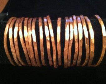 Thin hammered copper bangles, open in the back and adjustable to fit every wrist size