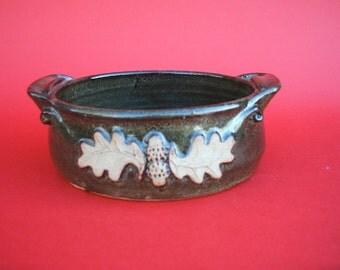 Hand thrown stoneware baking dish with oakleaf decoration.16cm x 6cm