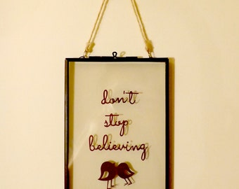 Don't stop believing - papercut in a see through frame