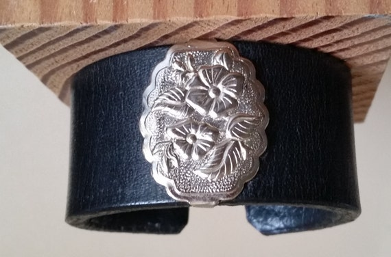 Women's BLACK LEATHER BRACELET with Bright Silver-Tone Wild Rose Concho. Lined. Medium Wide Cuff Wristband. Floral Western. Hook & Eye Clasp