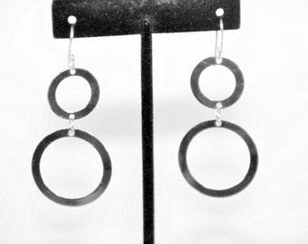 Handcrafted dangle double hoop silver earrings.