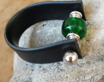 Unique beaded ring made from upcycled rubber.