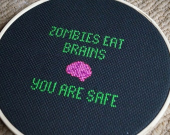 Zombies Eat Brains... You Are Safe Cross Stitch