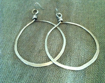 Handmade and hand hammered brass hoops.