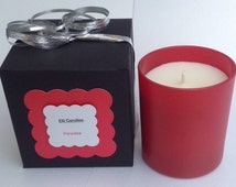 Handmade scented candle in a red glass jar with the scent of paradise. Comes with a lovely matching gift box!