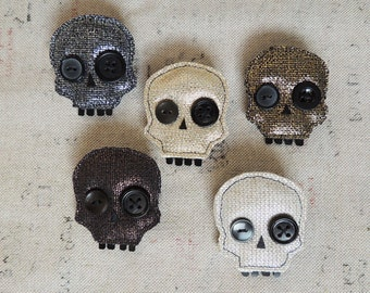Metallic waxed linen skull brooch