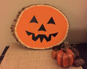 Jack-o-lantern wood slab sign