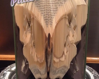 Book folding pattern for a BUTTERFLY