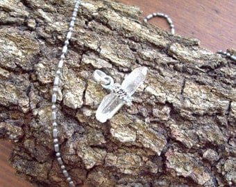 Crystal Pendant held in a Silver Band