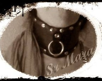 Collar leather with eyelet. Restriction. Black and nickel.