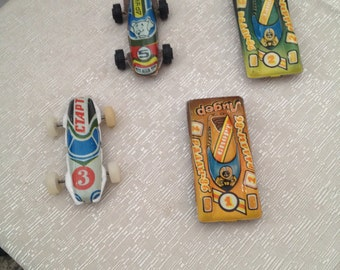 Tin toy cars 70 years