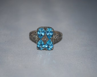 Sterling silver ring size 9.75 with Blue zircon and diamond chip.