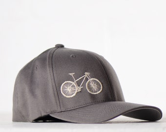 small - medium MOUNTAIN BIKE flexfit fitted hat, cream embroidery bicycle on charcoal cap