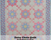 Daisy Chain Quilt Pattern. Combines traditional piecing with simple appliqué.