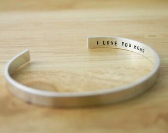 I Love You More Silver Cuff Bracelet. Sterling silver or aluminum custom stamped cuff bracelet.