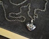 Grey Heart.  Gray Swarovski crystal heart pendant on sterling link and vintage gunmetal chain necklace