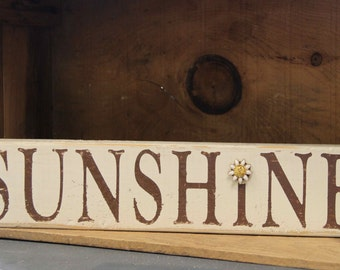 SUNSHINE cream and brown sign from reclaimed materials