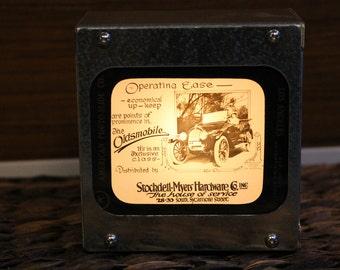 OLDSMOBILE AD #4 - Vintage magic lantern glass slide light box